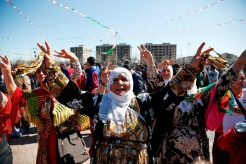 DIYARBAKIR, TURKEY - MARCH 21: Kurdish women gather as they dance during Newroz celebrations, on March 21, 2015 in Diyarbakir, Turkey. Thousands of Kurds gather for the Newroz spring festival in Diyarbakir in southeast Turkey under tight security after months of fighting between security forces and Kurdish separatists, and a series of bombings in Istanbul and Ankara. (Photo by Ulas Tosun/Getty Images)